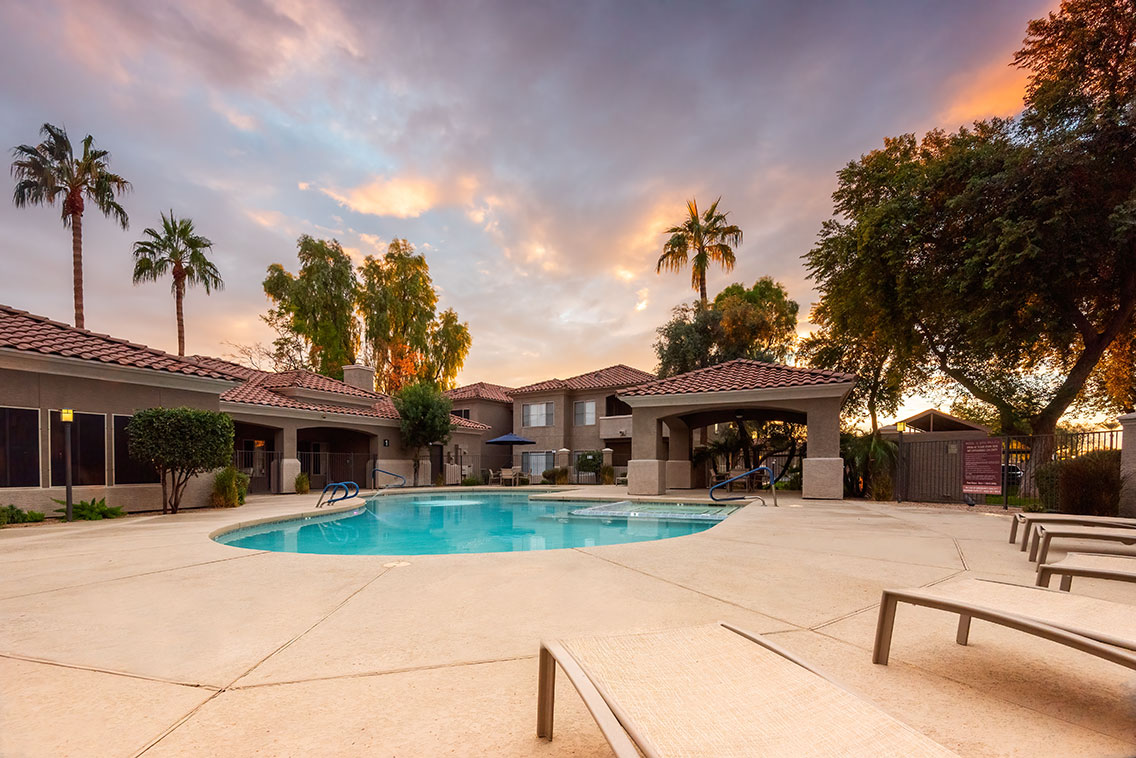 Traditions - Exterior of pool at sunset